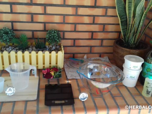 outdoor counter with organized soap ingredients and equipment