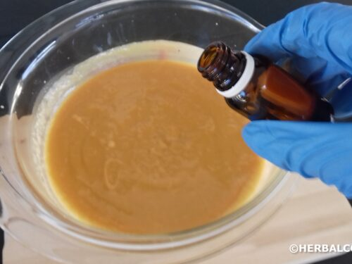 Pouring essential oils into soap batter