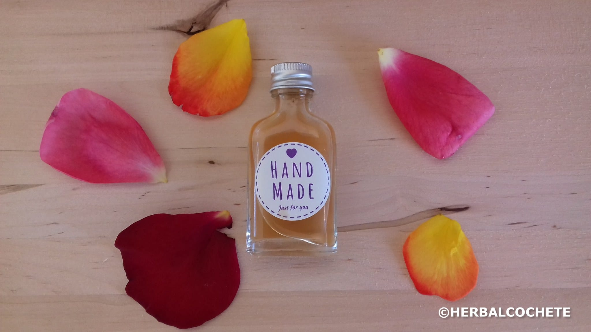 Small bottle with rose petals toner