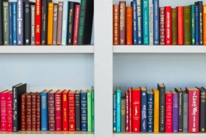 white bookshelf with colorful books