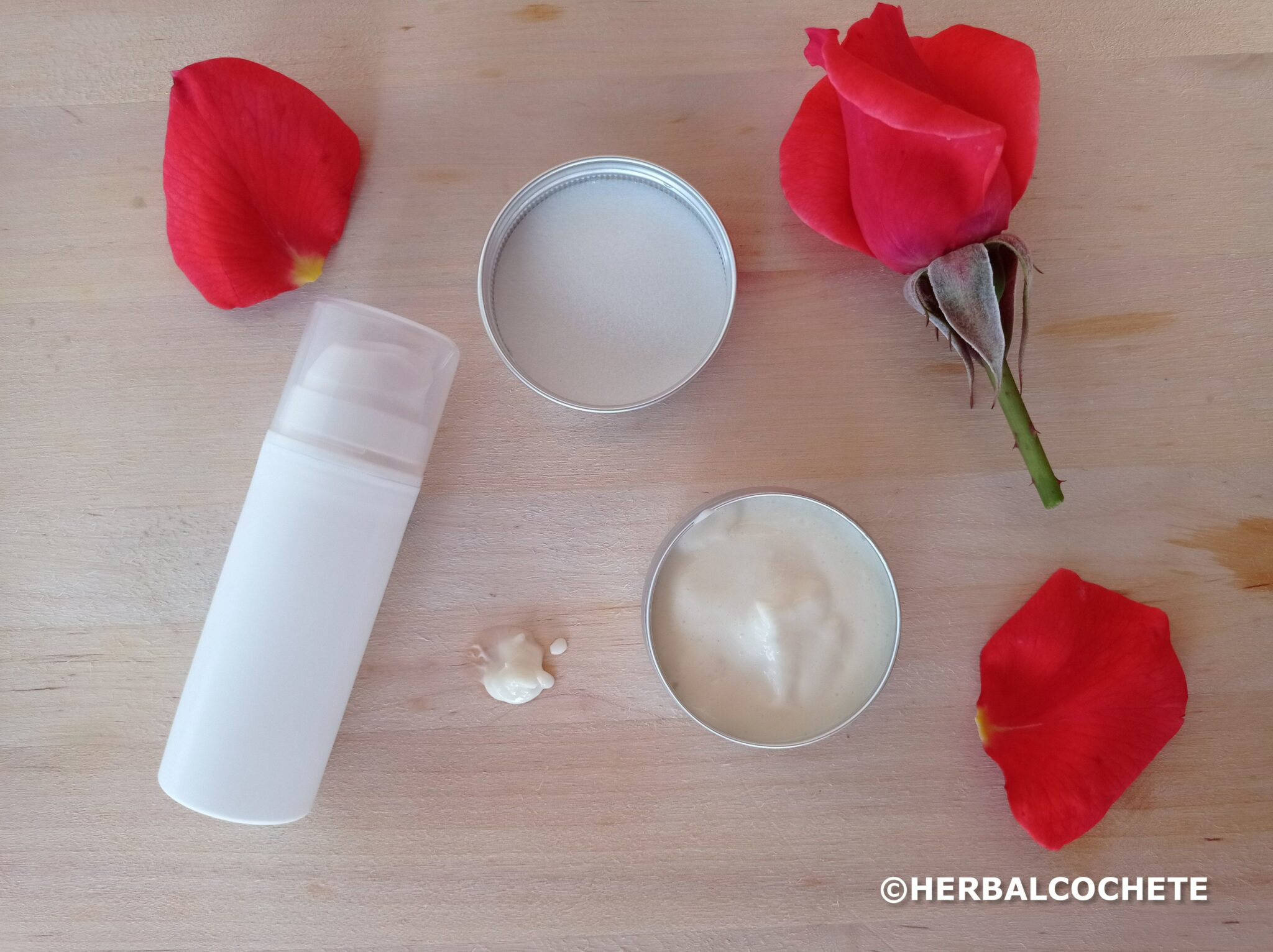airless bottle and cosmetic tin can with homemade face lotion, decorated with rose petals
