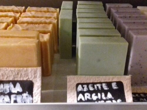 Several colored soaps curing in a rack