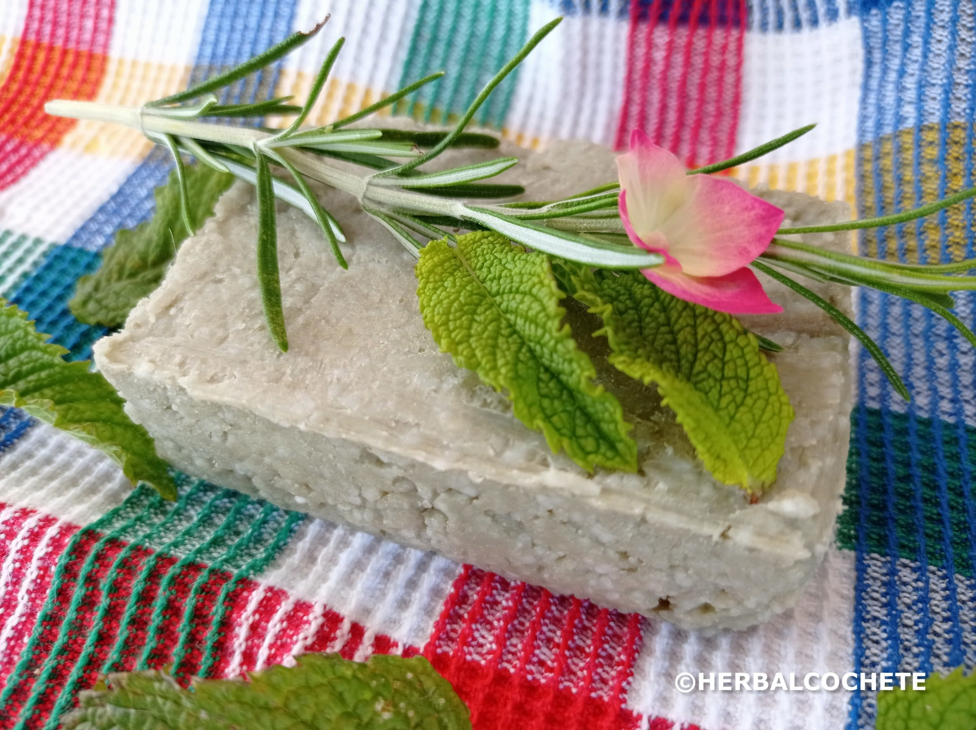 Green clay shampoo bar with herbs and flowers for decoration