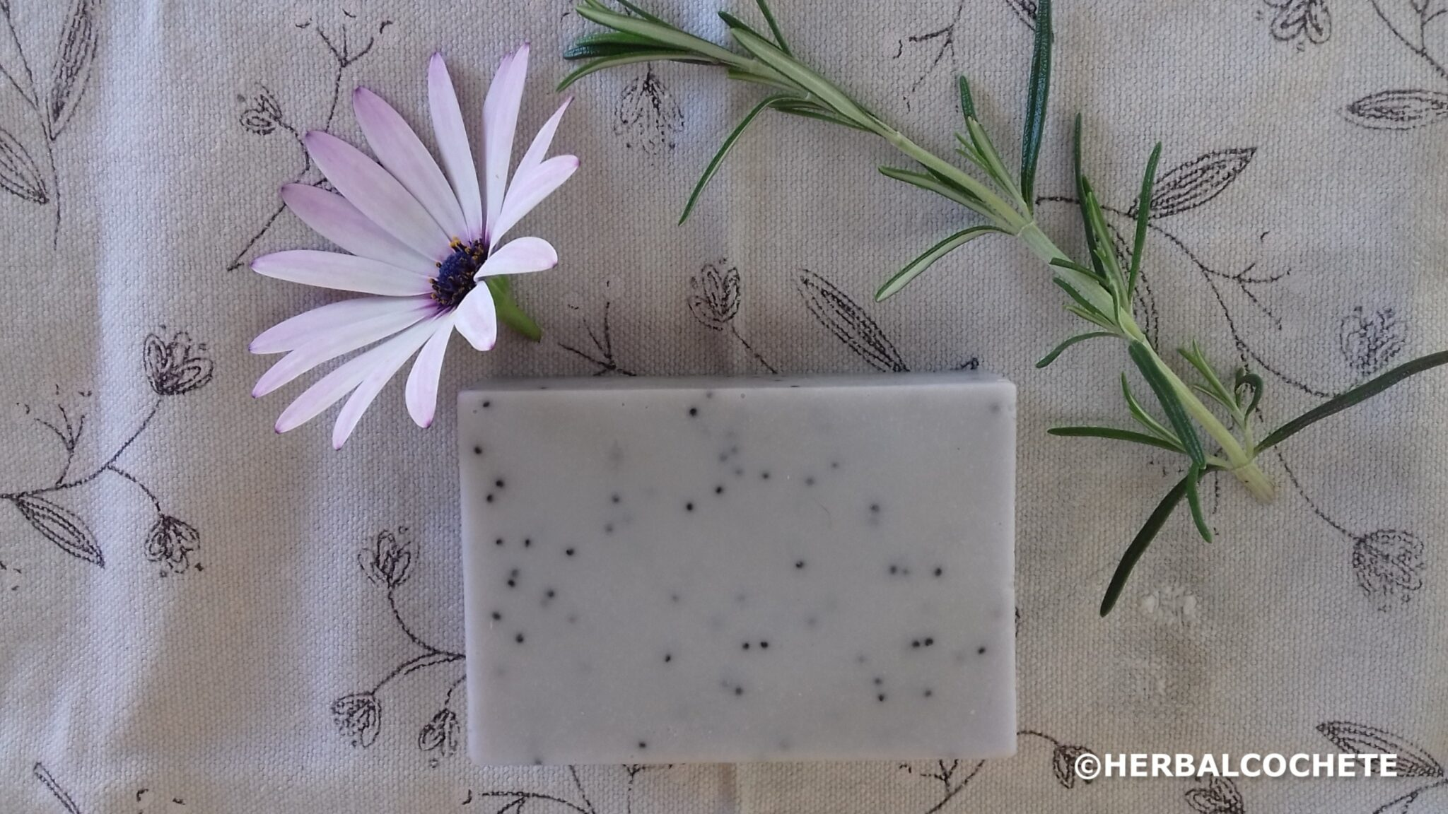 purple rosemary and lavender soap with poppy seeds with flower decoration